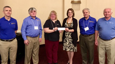 UFCU management and board of directors presents donation check
