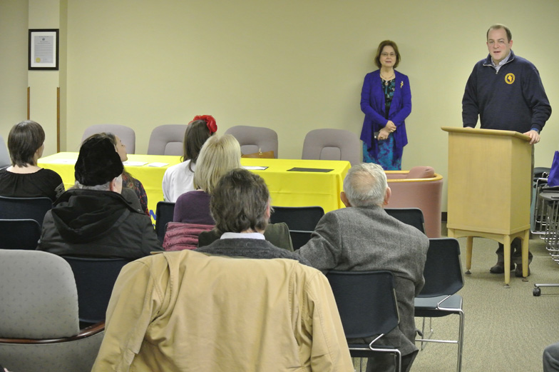Town Supervisor addresses audience from podium