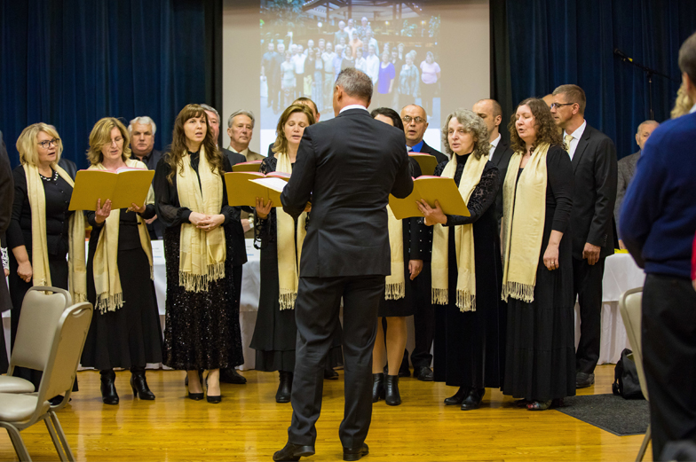 Choir singing at beginning of annual meeting