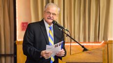 Male speaks at podium