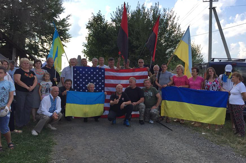 Group photo holding flags