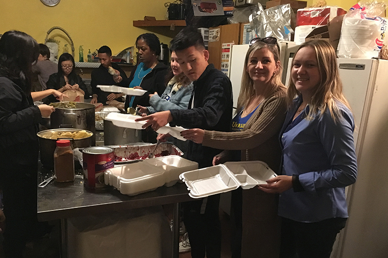 Two women helping serve food