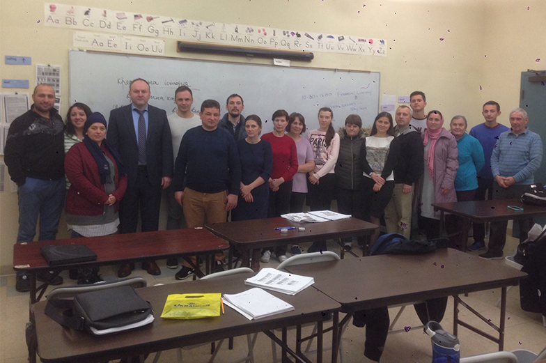Group photo of participants in a financial education class