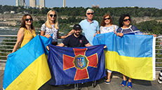 Group photo with people holding flags
