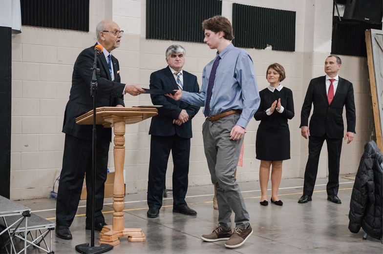student receives scholarship certificate