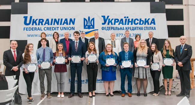 group of students standing with certificates