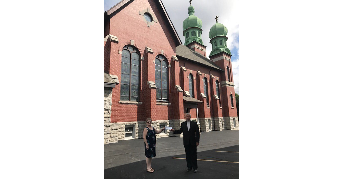 Female male standing outside of church