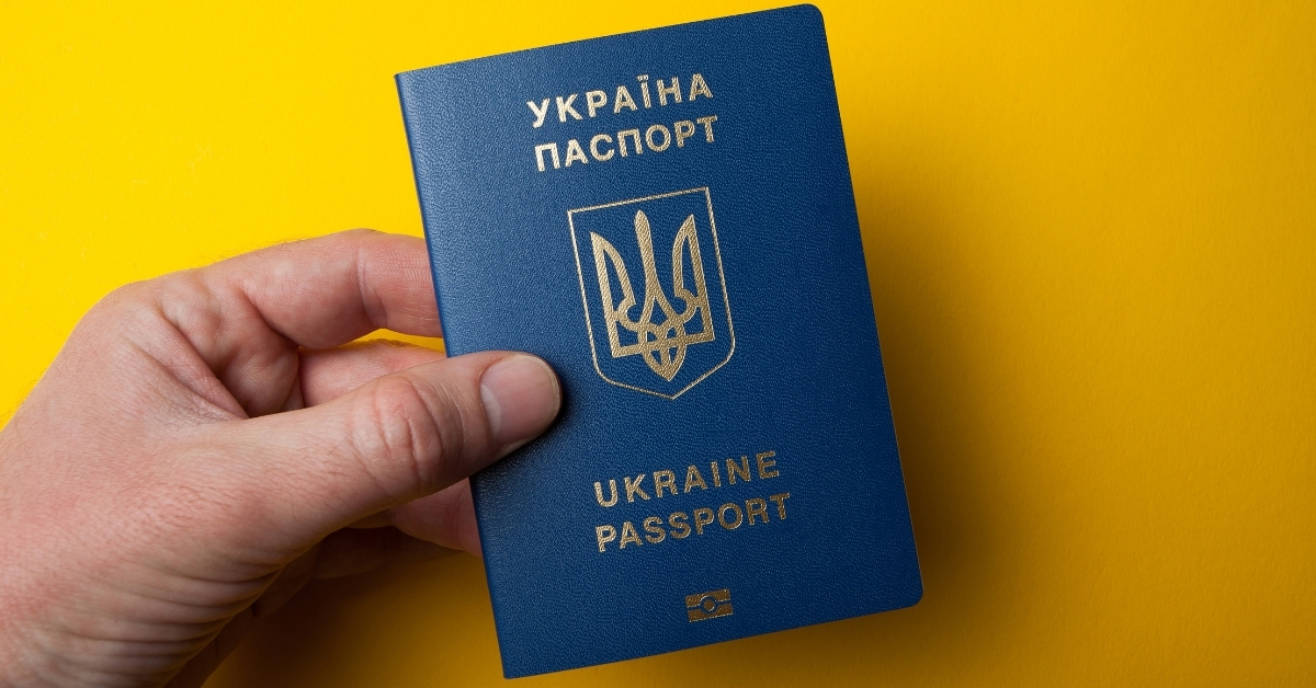 Ukrainian passport in hand