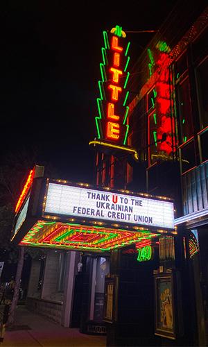 Illuminated sign at movie theater