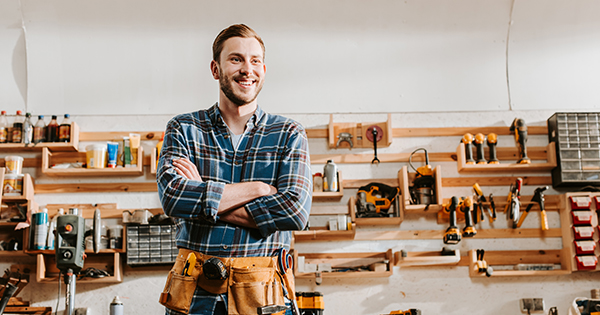 Carpenter Smiling In Work Shop