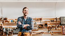 Happy Carpenter In Work Shop